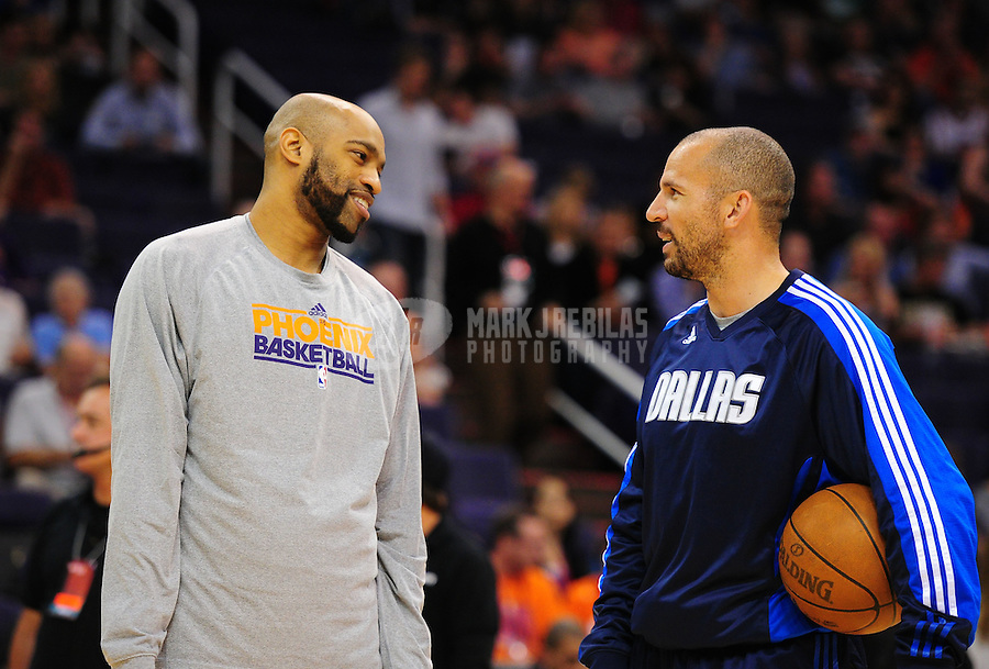 Mar. 27, 2011; Phoenix, AZ, USA; Dallas Mavericks guard Jason Kidd (right) talks with Phoenix Suns guard Vince Carter prior to the game at the US Airways Center. The Maverick defeated the Suns 91-83. Mandatory Credit: Mark J. Rebilas-