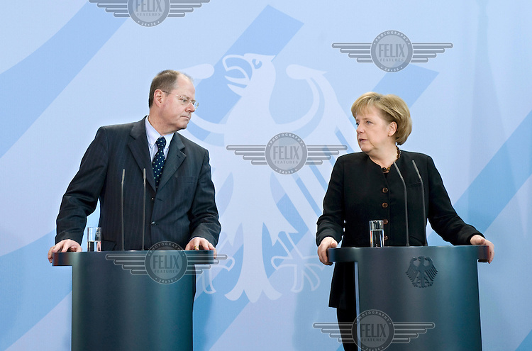Peer Steinbrueck, Federal Minister of Finance, and Chancellor Angela Merkel at a press call of the G20 summit, where the leaders of the G20 nations are to discuss common measures on combating the current global economic slowdown and restructuring the world finance system.