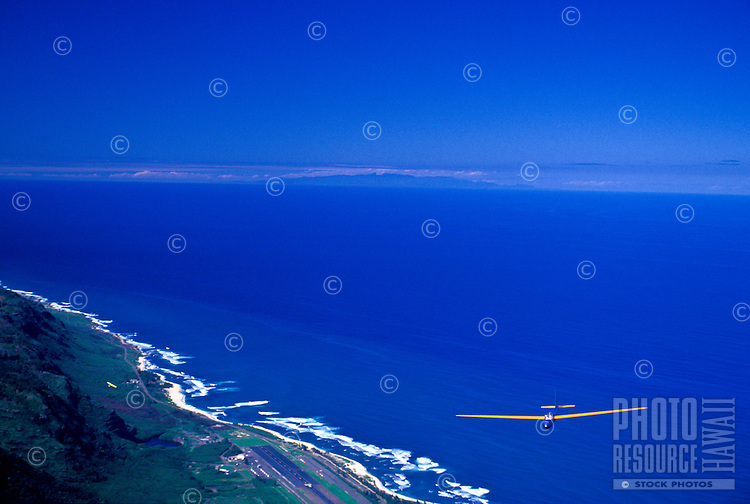 Glider soaring over North Shore coastline and ocean