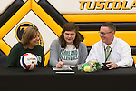 March 1, 2017- Tuscola, IL- Maddie Allen signs her letter of intent to continue her volleyball career with the Parkland Cobras as mother Tonya Allen and father Brad Allen look on. [Photo: Douglas Cottle]