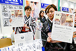Exhibitors pose for a photograph during the Japan Halal Expo 2015 on November 25, 2015, Chiba, Japan. The Japan Halal Expo 2015 is a trade show which introduces various Japanese Halal products and services held at Makuhari Messe International Convention Complex. About 100 companies and organizations attend this year's two day event aiming to make Japan more friendly to Muslim visitors. This year's main sponsor is YouCoJapan, a website which provides information for Muslim travelers to Japan and business consultation about the Muslim markets. Organizers estimated that approximately 3,280 visitors attended in 2014 and similar numbers are expected this year. In 2013, the Japan National Tourist Organisation reported that the tourists from Muslim-Majority countries including Malaysia and Indonesia increased thanks to visa relaxations, and Japan hopes to continue to attract even more. (Photo by Rodrigo Reyes Marin/AFLO)