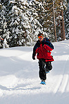 California: Northstar at Lake Tahoe, man snowshoeing.    Photo copyright Lee Foster.  Photo # cataho100481