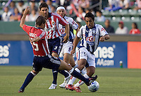 Chivas midfielder Jesse Marsch (15) tackles Pachuca midfielder Paul Aguilar (22) during a SuperLiga match. Pachuca CF defeated the Chivas USA 2-1 during the 1st round of the 2008 SuperLiga at Home Depot Center stadium, in Carson, California on Sunday, July 13, 2008.
