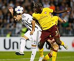 Partizan player Nemanja Tomic, left, jump for the ball withBacary Sagna,  during  UEFA Champions league match in group H FC Partizan Belgrade Vs. Arsenal, London, Serbia, Monday, Sept. 28, 2010.  (Srdjan Stevanovic/Starsportphoto.com)