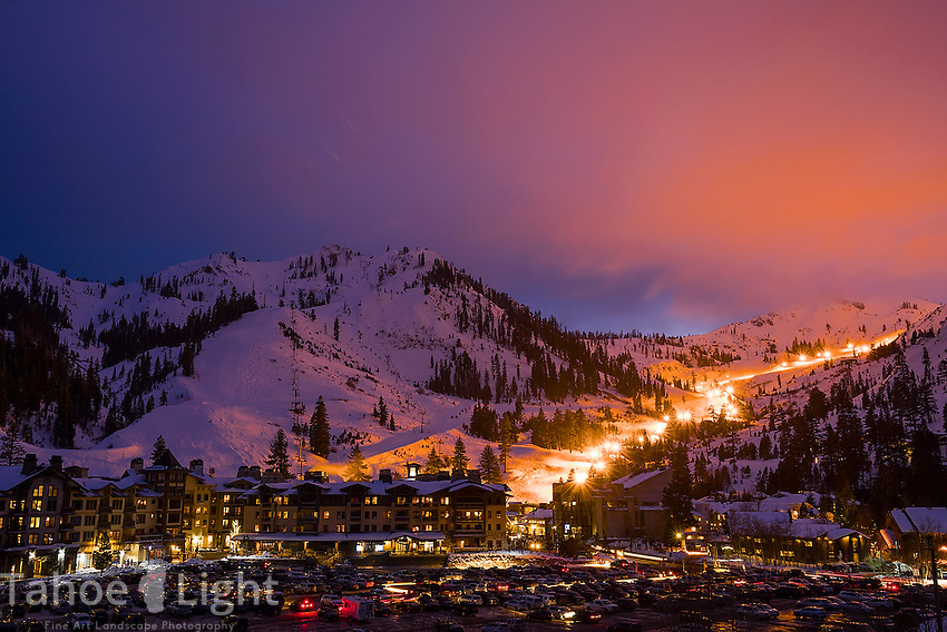 Squaw Valley Ski Resort in Lake Tahoe, night skiing with the mountain run lit up New Year's Eve.