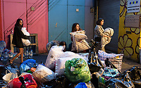 Some of the hundreds of people donating for the victims of the North kensington Grenfell Tower fire, June 14, 2017. The Maxilla Hall Club, under the Westway was one of many centres overwelmed with donations by the public. <br /> CAP/CAM<br /> &copy;Andre Camara/Capital Pictures /MediaPunch ***NORTH AND SOUTH AMERICAS ONLY***