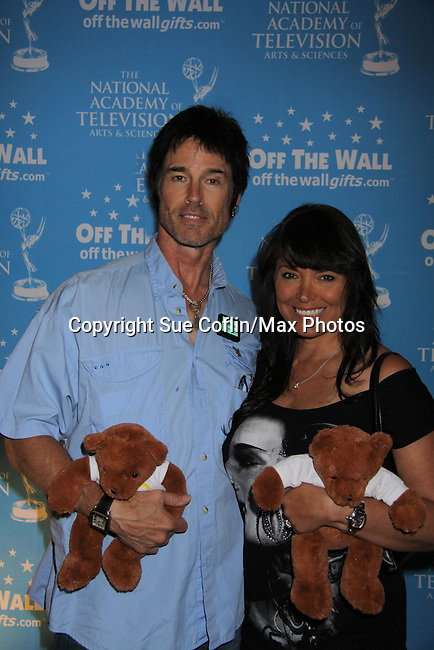 The Bold and The Beautiful Ronn Moss is a presenter and poses with his wife Devonn at the gifting suite at the 38th Annual Daytime Entertainment Emmy Awards 2011 held on June 19, 2011 at the Las Vegas Hilton, Las Vegas, Nevada. (Photo by Sue Coflin/Max Photos)