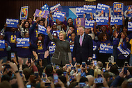 Fairfax, VA - February 29, 2016: Former U.S. Secretary of State and 2016 presidential candidate Hillary Clinton waves to supporters during a campaign event at the George Mason University in Fairfax, VA, February 29, 2016, as Virginia Gov. Terry McAuliffe looks on.  (Photo by Don Baxter/Media Images International)