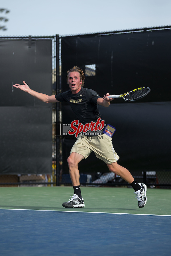 Romain Bogaerts of the Wake Forest Demon Deacons reacts to a call during his singles match against North Carolina Tar Heels at the Wake Forest Tennis Center on April 11, 2015 in Winston-Salem, North Carolina.  The Demon Deacons defeated the Tar Heels 4-3.    (Brian Westerholt/Sports On Film)