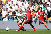 Barclay Premier League, Swansea City (white) V Liverpool (red) Liberty Stadium, 13/05/12<br /> Pictured: Danny Graham spins away from the challenge of Daniel Agger<br /> Picture by: Ben Wyeth / Athena <br /> info@athena-pictures.com