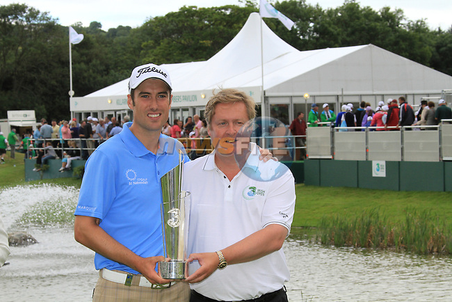 Ross Fisher being presented with the  3 Irish Open, trophy by Robert Finnegan CEO of 3 Ireland, at the Killarney Golf and Fishing Club, Killarney, Ireland.Picture Eoin Clarke/www.golffile.ie.