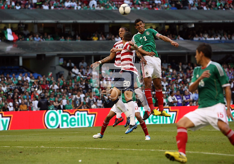 MEXICO CITY, MEXICO - AUGUST 15, 2012:  Jermaine Jones (13) and Geoff Cameron (20) of the USA MNT up for a header against Fransisco (Maza) Javier Rodriguez (2) of  Mexico during an international friendly match at Azteca Stadium, in Mexico City, Mexico on August 15. USA won 1-0.