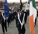 Republicans carrying republican and Irish tricolor flags marching though the village of Carrickmore, Sunday April 12, 1998, on the anniversary commemoration rally marking the 1916 Easter uprising against the British. Hundreds of Republicans mark the event by rallies all over Northern Ireland. (AP Photo/Paul McErlane)