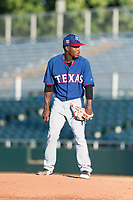 AZL Rangers relief pitcher Ediberto Encarnacion (31) looks in for the sign during an Arizona League game against the AZL Giants Black at Scottsdale Stadium on August 4, 2018 in Scottsdale, Arizona. The AZL Giants Black defeated the AZL Rangers by a score of 3-2 in the first game of a doubleheader. (Zachary Lucy/Four Seam Images)