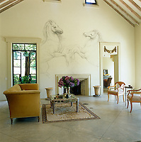 The freshly stuccoed walls of the living room are bare except for a large equine mural by artist Tom Hooper