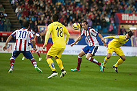 Atletico de Madrid´s Diego Godin, Arda Turan and Villarreal´s Jaume Costa during 2014-15 La Liga match between Atletico de Madrid and Villarreal at Vicente Calderon stadium in Madrid, Spain. December 14, 2014. (ALTERPHOTOS/Luis Fernandez) /NortePhoto