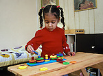 Berkeley CA Girl, three-years-old sorting objects according to shape (using learning game at home)  MR