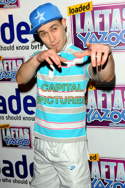 Lee Nelson.Loaded Laftas at the Cuckoo Club, Piccadilly, London, England..February 8th, 2012.half length blue shirt polo baseball cap hat white stripe hands arms pointing .CAP/CJ.©Chris Joseph/Capital Pictures.