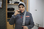 A Palestinian woman security guard from Secure Land company for security and logistics services takes part in a work day at bank of Palestine in Gaza City on March 19, 2018. Secure land is the first security company for women on Gaza strip. Photo by Mahmoud Ajour