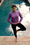 Hispanic woman doing yoga pose