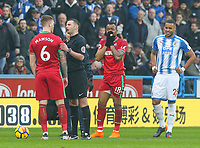Swansea City's Jordan Ayew reacts after being shown a straight red card by referee Michael Oliver<br /> <br /> Photographer Alex Dodd/CameraSport<br /> <br /> The Premier League - Huddersfield Town v Swansea City - Saturday 10th March 2018 - John Smith's Stadium - Huddersfield<br /> <br /> World Copyright &copy; 2018 CameraSport. All rights reserved. 43 Linden Ave. Countesthorpe. Leicester. England. LE8 5PG - Tel: +44 (0) 116 277 4147 - admin@camerasport.com - www.camerasport.com