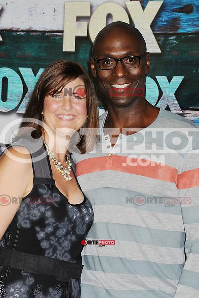 WEST HOLLYWOOD, CA - JULY 23: Lance Reddick and wife Stephanie Reddick arrive at the FOX All-Star Party on July 23, 2012 in West Hollywood, California. / NortePhoto.com<br /> <br /> **CREDITO*OBLIGATORIO** *No*Venta*A*Terceros*<br /> *No*Sale*So*third* ***No*Se*Permite*Hacer Archivo***No*Sale*So*third*©Imagenes*con derechos*de*autor©todos*reservados*. /eyeprime