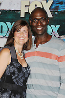 WEST HOLLYWOOD, CA - JULY 23: Lance Reddick and wife Stephanie Reddick arrive at the FOX All-Star Party on July 23, 2012 in West Hollywood, California. / NortePhoto.com<br />
