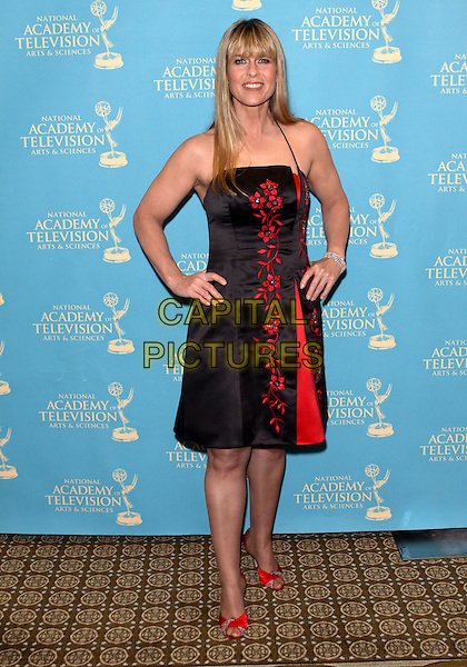 TERRI IRWIN.36th Annual Daytime Creative Arts  Emmy Awards held  at The Westin Bonaventure Hotel, Los Angeles, California, USA..August 29th, 2009.full length black dress shoes red pattern hands on hips .CAP/ADM/TC.©T. Conrad/AdMedia/Capital Pictures.