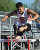 Alexandro Vaszuez of Connetquot races to victory in the 400 meter intermediate hurdles event during a Suffolk County boys' track and field meet against Middle Country at Connetquot High School on Thursday, May 14, 2015.<br /> <br /> James Escher