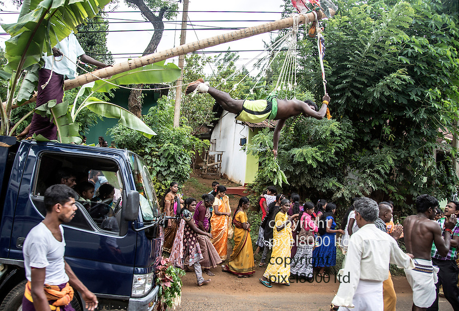 Sri Lanka selection<br /> Hindu ritual of hanging by skin from hooks - snatched from passing bus window<br /> <br /> <br /> Picture by Gavin Rodgers/ Pixel8000<br />  07917221968