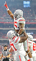 Ohio State Buckeyes running back Ezekiel Elliott (15) celebrates his second quarter TD with Ohio State Buckeyes defensive lineman Robert Landers (57)  against Notre Dame at University of Phoenix Stadium in Glendale, AZ on January 1, 2016.  (Chris Russell/Dispatch Photo)