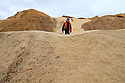 TO GO WITH STORY BY Arthur Beesley. DATE 8 FEB 2018. Ryan McDonagh walks over residue (Wood chip & Sawdust mixed) mound outside the CHP Plant. Balcas Timber Ltd,  Laragh, Ballinamallard, Enniskillen Co. Fermanagh, Northern Ireland. Photo/Paul McErlane