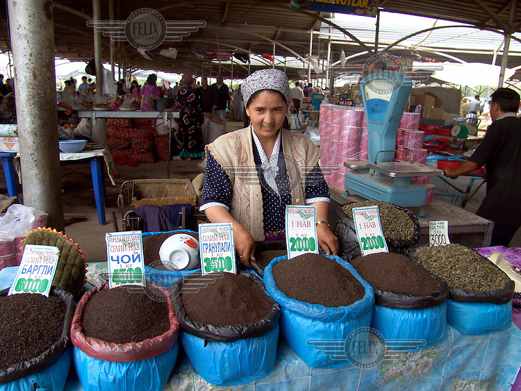 Woman selling different varieties of tea, both black and green, at the Chorsu bazaar..