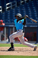 Miami Marlins Dalvy Rosario (98) at bat during an Instructional League game against the Washington Nationals on September 26, 2019 at FITTEAM Ballpark of The Palm Beaches in Palm Beach, Florida.  (Mike Janes/Four Seam Images)