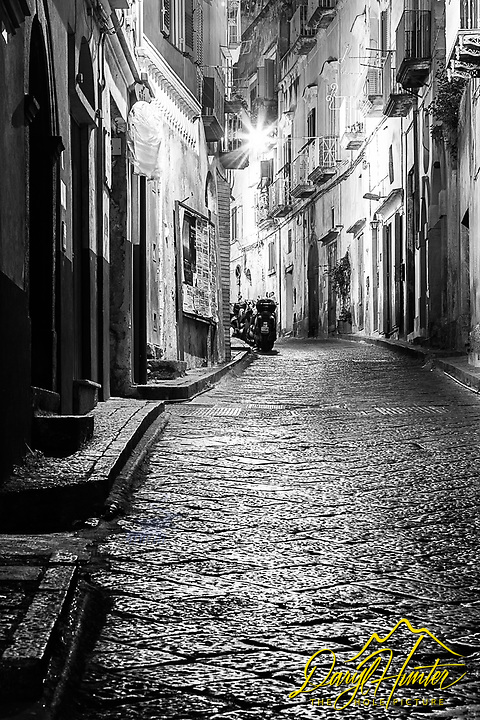 A deserted cobblestone street in Procida Italy. It is amazing the peace and tranquility you can find in an ancient Italian Village at 5AM in the morning. <br />