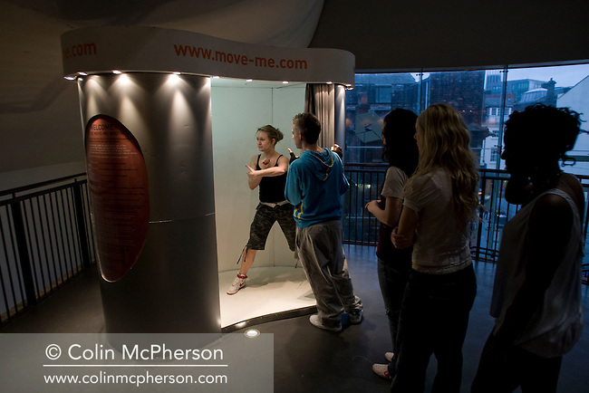 Dance students from the Liverpool Institute of Performing Arts (LIPA) testing the Move-me Booth, a mobile dance studio which records dancers own creative moves at FACT in Liverpool. The dance moves are recorded and subsequently edited by a team of top choreographers with the results being posted on line. The booth, which has been located at various venues across the UK will be in Liverpool until March 17, as part of the city's celebrations as 2008 European Capital of Culture before going on tour to New Zealand and Australia. Further information from www.move-me.com.