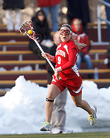 Boston University defender Christie Hart (9) brings the ball forward. .Boston College (white) defeated Boston University (red), 12-9, on the Newton Campus Lacrosse Field at Boston College, on March 20, 2013.