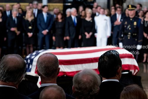 Congressional and executive leadership along with the family of Sen. John McCain, R-Ariz., watch as his casket is laid in state in the Rotunda of the U.S. Capitol, Friday, Aug. 31, 2018, in Washington. (AP Photo/Andrew Harnik, Pool)