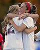 Garden City No. 14 Isabel Klatt (red head band) congratulates No. 12 Chloe Stapleford after she scored a goal in the second minute of a Nassau County varsity girls' soccer Class A semifinal against Island Trees at Cold Spring Harbor High School on Friday, October 30, 2015. Klatt scored Garden City's second goal early in the second half in their 2-0 win.<br /> <br /> James Escher
