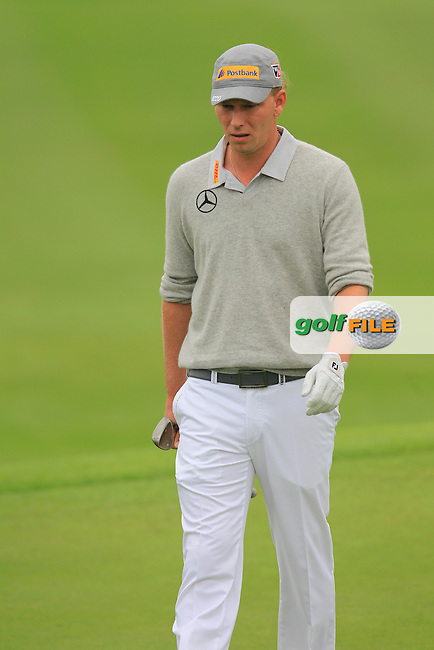 Marcel Siem (GER) on the 1st green during Saturay's Round 3 of the 2014 BMW Masters held at Lake Malaren, Shanghai, China. 1st November 2014.<br /> Picture: Eoin Clarke www.golffile.ie