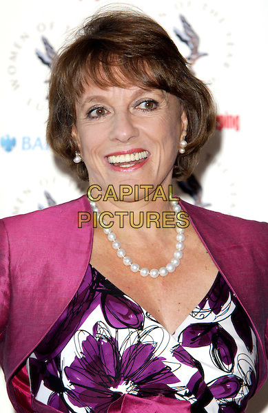 ESTHER RANTZEN .At the Women of the Year Lunch,  Intercontinental Hotel, London, England, UK, October 12th 2009..portrait headshot pink white floral print necklace beads pearl pearls purple .CAP/CJ.©Chris Joseph/Capital Pictures.
