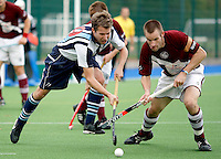 Mike Williamson (L) of Hampstead takes on Jon Bleby during the England Hockey League Mens Premier Division game between Hampstead & Westminster HC and Loughborough Students at The Paddington Recreation Ground, London on Sun Nov 8, 2009