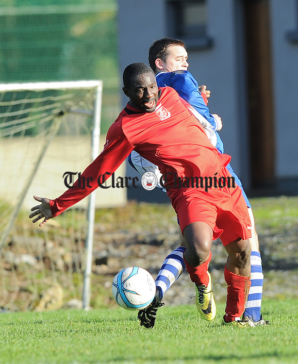 TJ Ajisomo of Lifford FC in action against Shane Mc Namara of Tulla United  during their Munster Junior Cup game in Tulla. Photograph by John Kelly.