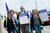 Southampton Itchen Bridge toll collectors, who are on strike, walking across the bridge to a rally and march.