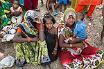 Bhagwati,(left) mother in law to 22 year old Preeti with their kids near  Silanagar village outside Shivpuri in Madhya Pradesh state in India. Ignoring offers of help for her malnourished child she simply turned on her heels and left knowing the elder males of the village would refuse permission for her to leave. Despite 15 yeas of economic growth the incidence of child malnutrition has barely changed -- 46 percent of children under 5 in India are malnourished: twice the rate of sub Saharan Africa.. A report released last week said a mixture of poor governance , the caste system dis-empowerment of women and superstition are preventing children from getting the nutrition they need, condemning another generation to brain damage, low earning potential and early death. At the moment 3000 children a day die in India as a result of malnutrition.