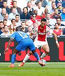 Nederland, Amsterdam, 24 augustus 2014<br /> Eredivisie<br /> Seizoen 2014-2015<br /> Ajax-PSV <br /> Anwar El Ghazi (r.) van Ajax in actie met bal. Links Jetro Willems van PSV.