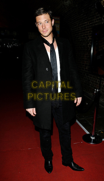 """DUNCAN JAMES .At """"The Pretender Agenda"""" Press Night, New Players Theatre,The Arches,  Villiers Street, London, England, .August 28th 2008..full length black scarf coat jeans shoes .CAP/CAN.©Can Nguyen/Capital Pictures"""