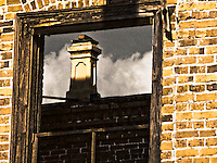 View through window in wall of ruins--old hotel, Blackville, SC-
