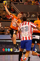 25.03.2012 MADRID, SPAIN -  EHF Champions League match played between BM At. Madrid vs Kadetten Schaffhausen (26-30) at Palacio Vistalegre stadium. the picture show Peter Kukucka (Kadetten Schaffhausen player) and Didier Dinart (BM Atletico de Madrid)