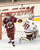 Liza Ryabkina (Harvard - 3) celebrates Kate Buesser's goal. - The Boston College Eagles defeated the visiting Harvard University Crimson 6-2 on Sunday, December 5, 2010, at Conte Forum in Chestnut Hill, Massachusetts.